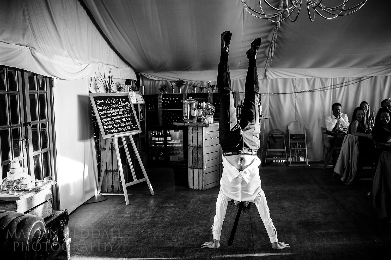 Groom does a handstand at River Cottage wedding