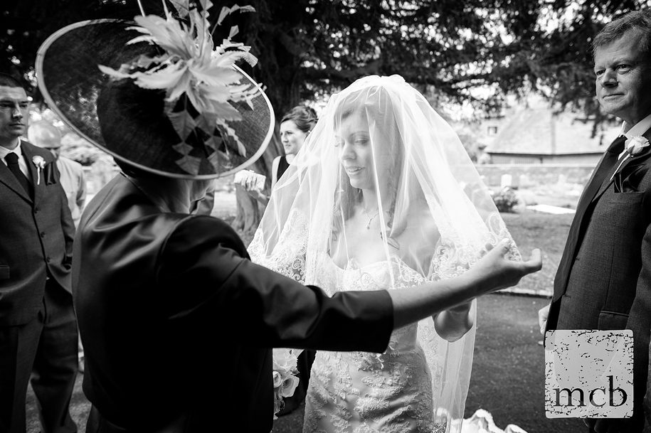 Bride has her veil adjusted by her mother