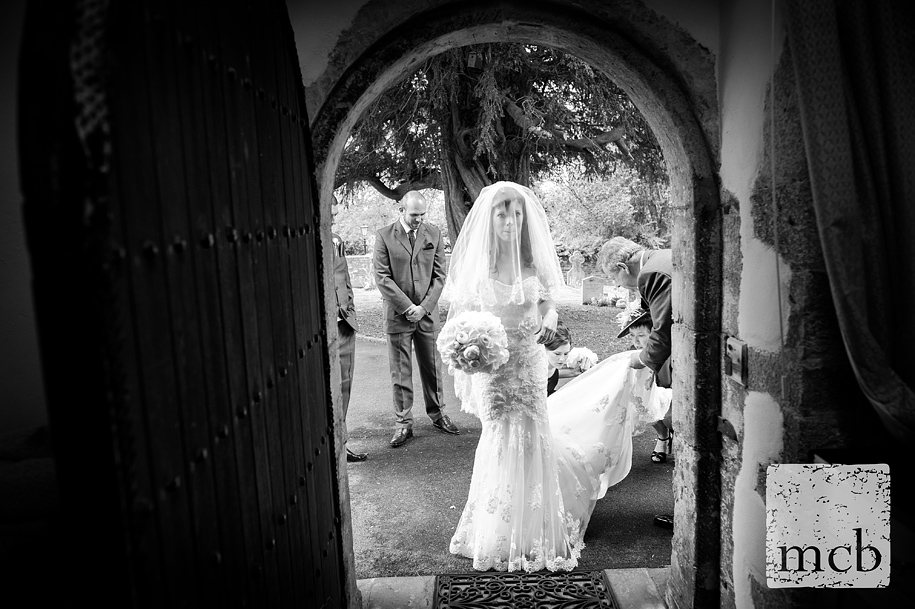 Bride looks nervous before she enters the church