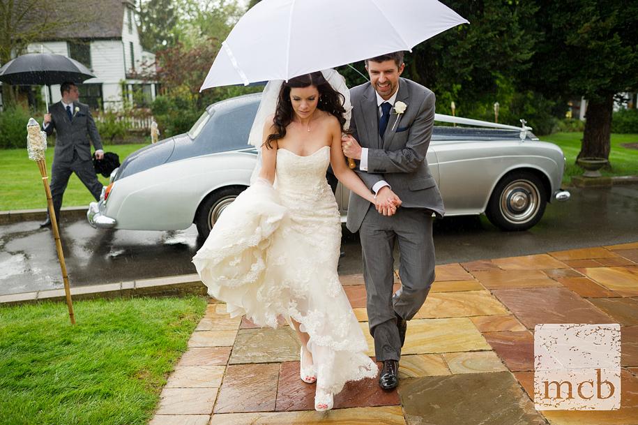 Bride and groom dodge the rain