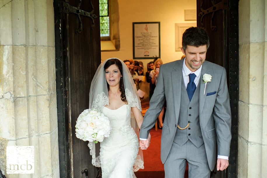 Bride sees the heavy rain as she leaves the church