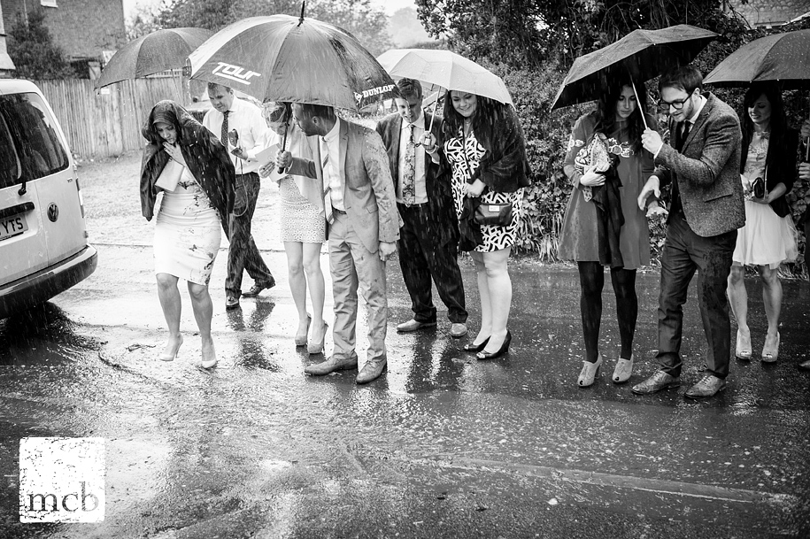 Wedding guests encounter a stream