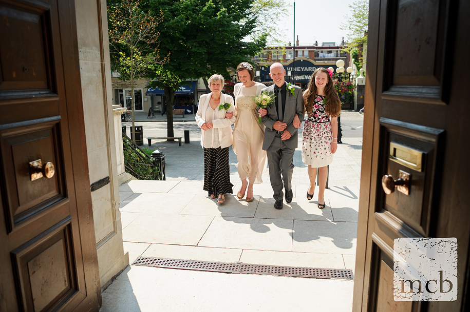 Brdie and her family enter Islington town hall