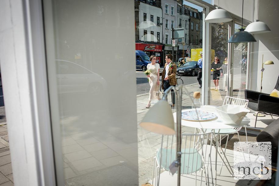 Bride and groom walk down Upper street