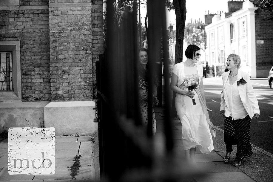 Bride shares a joke with her mother enroute to the wedding reception in Islington