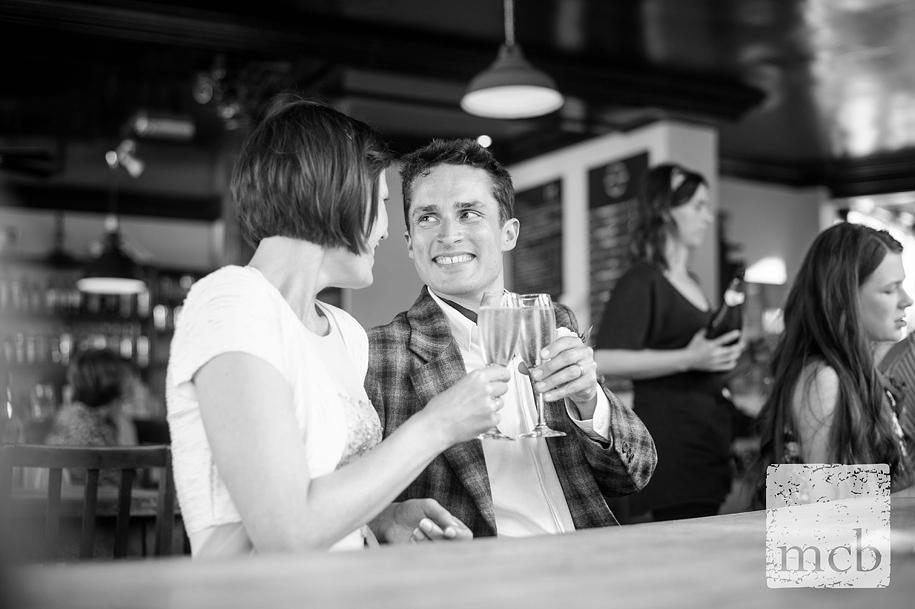 Brdie and groom toast themselves