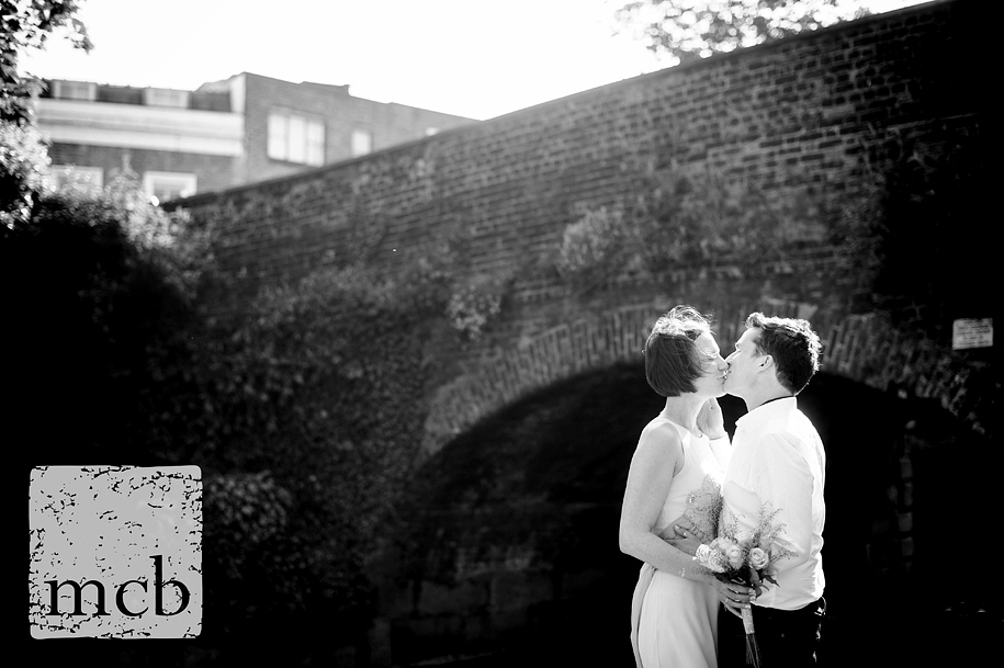 Bride and groom portrait by the canal in Islington