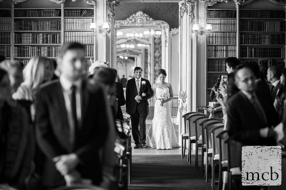 Bride and her father enter the library