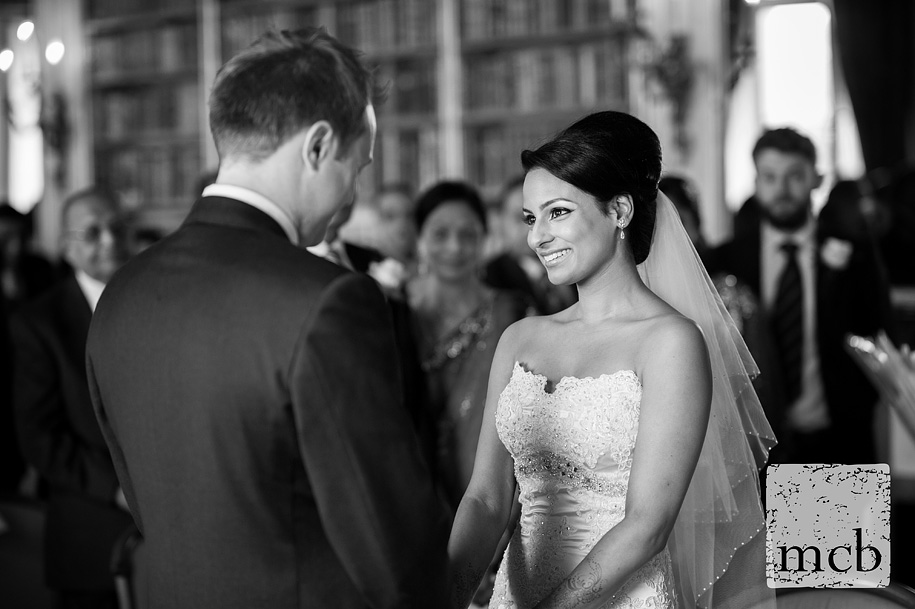 Bride smiles at the groom during the wedding ceremony