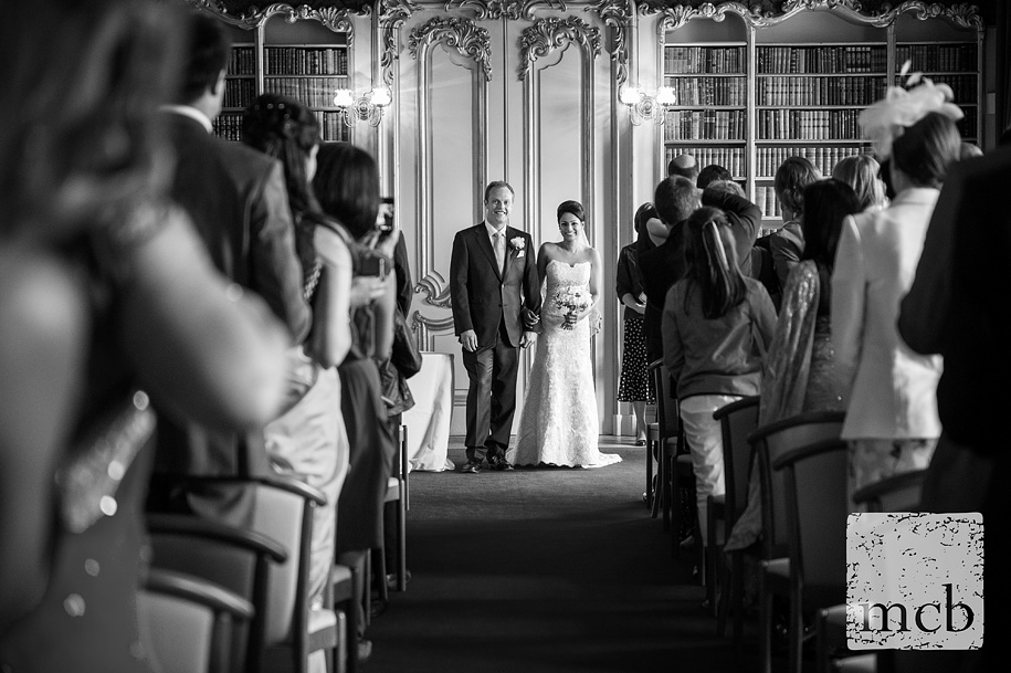 Bride and groom walk back down the aisle at Wrest Park wedding