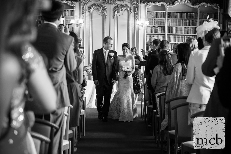Bride and groom walk back down the aisle at Wrest Park