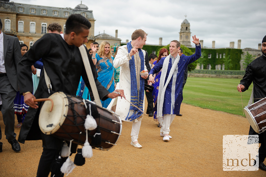 Led by drummers the groom dances his way to the orangery at wrest park