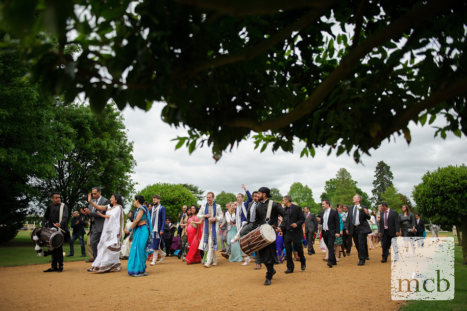 Procession leads to the orangery wedding ceremony
