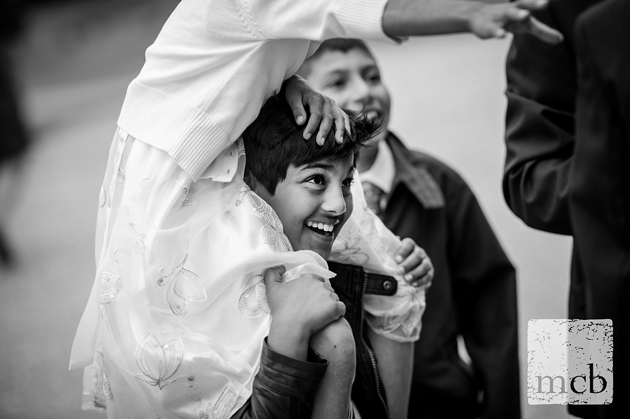 Smiling boy giving a piggy back at a wedding reception