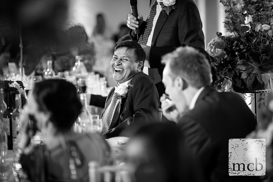 Bride's father laughing