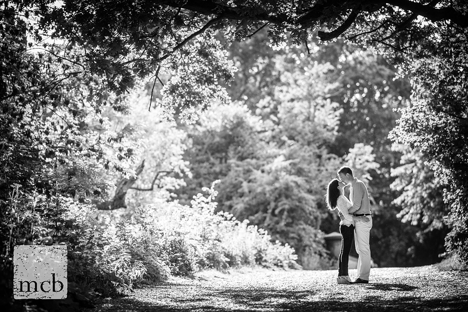 Backlit B&W shot of the couple kissing on the Heath