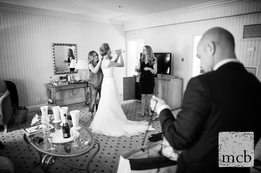 Bride swigs some water in her room