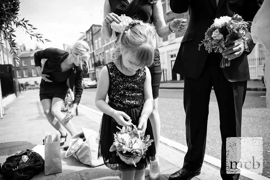 Flowergirl examines her flowers