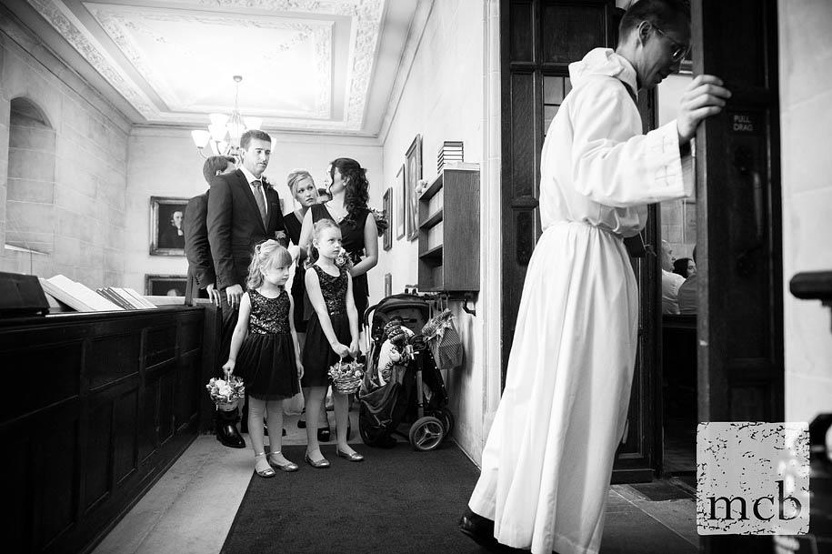 Bridal party prepare the enter