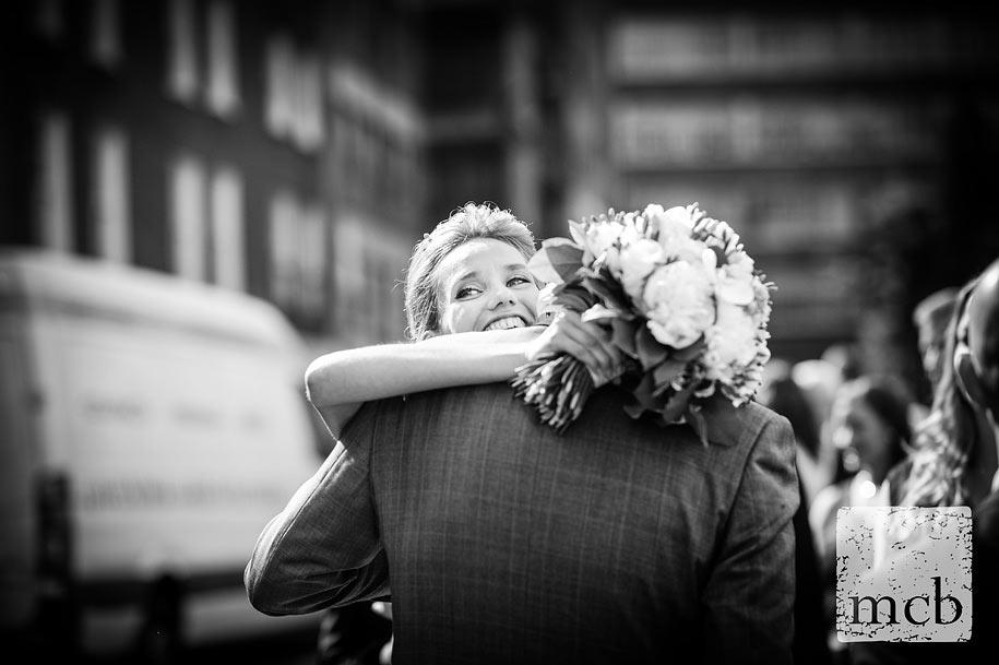 Bride hugs a friend