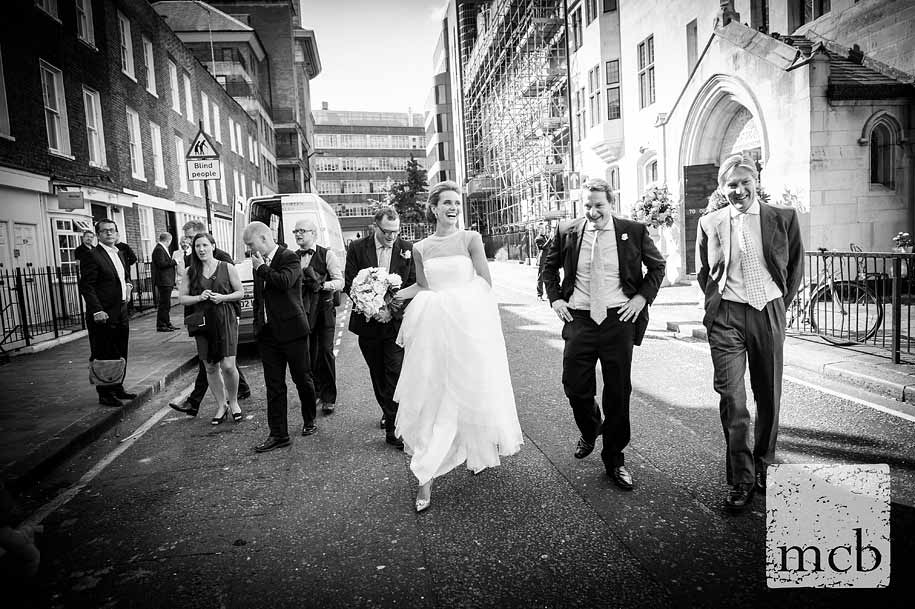 Bride leads guests towards the routemaster bus