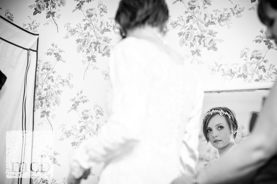 Bride getting dressed at wadhurst castle