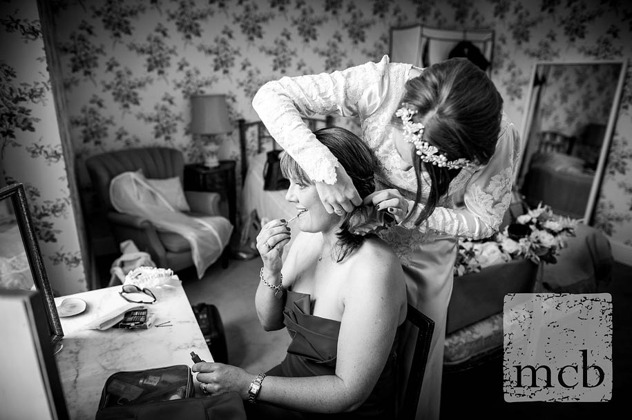 Bride helps her sister get ready for the wedding