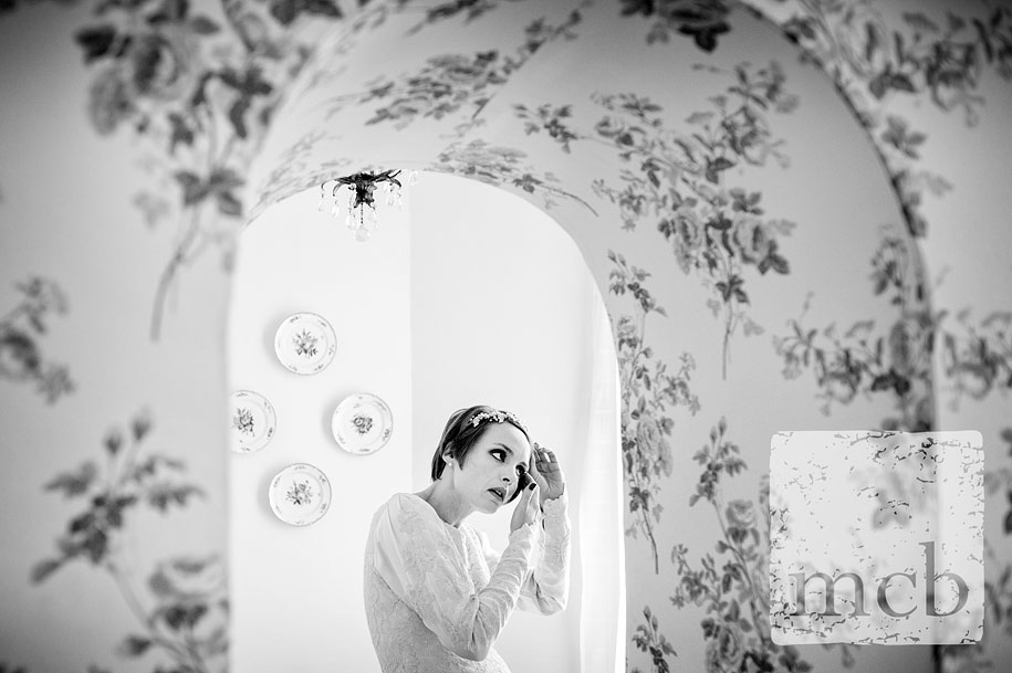 Bride adjusts her hair