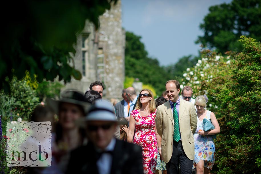wedding guests head to the walled garden