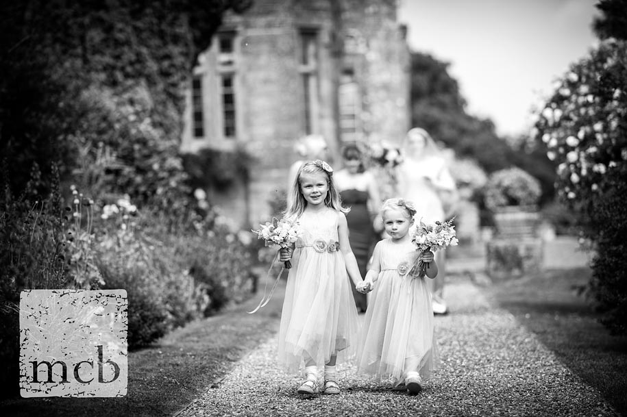 Flowergirls lead the bride to the wedding ceremony