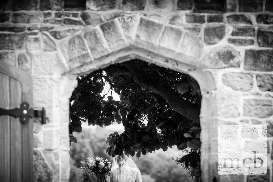 Bride prepares to enter the walled garden