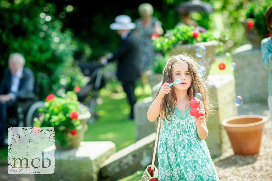 young wedding guests blowing bubbles