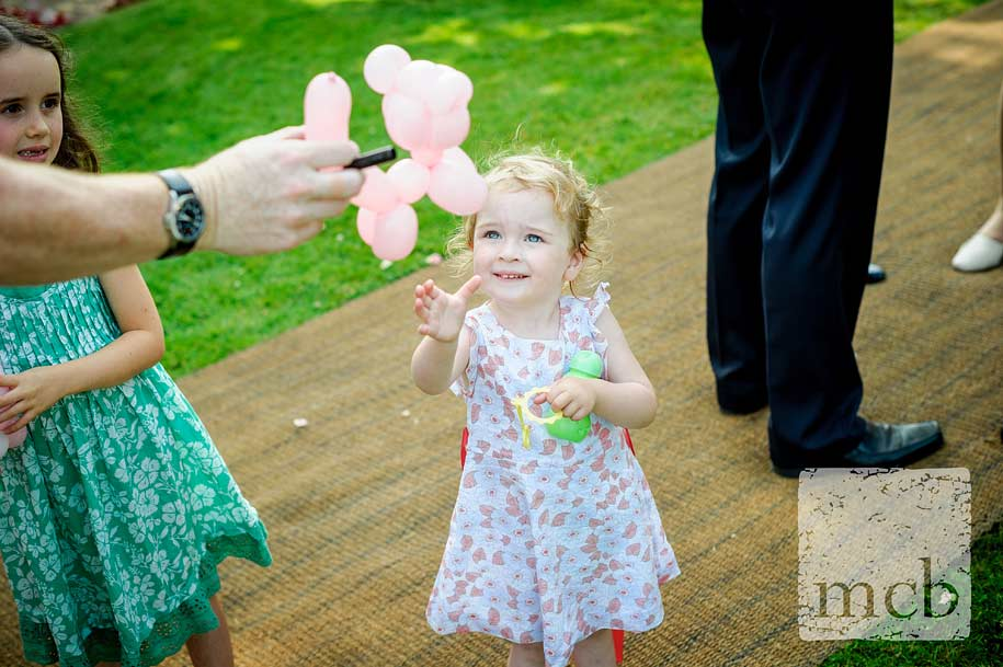 Young girls reaches out for a balloon animal