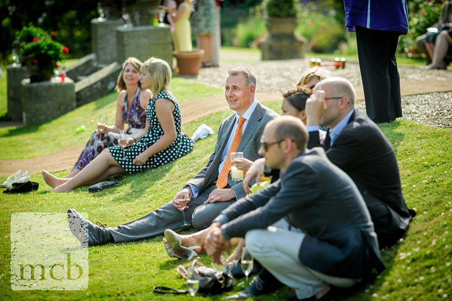 wedding guests sat on the terrace at wadhurst castle