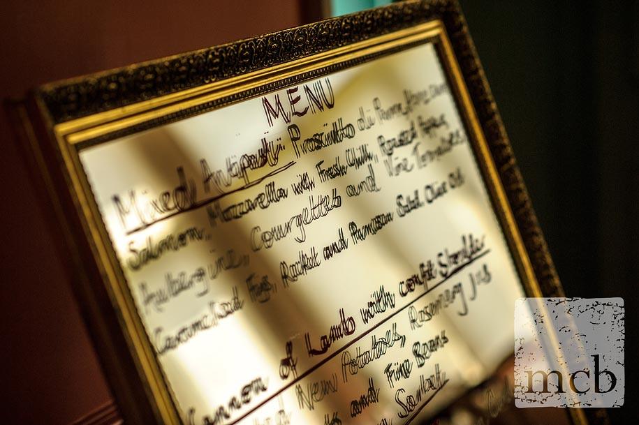 wedding breakfast menu written on a large mirror