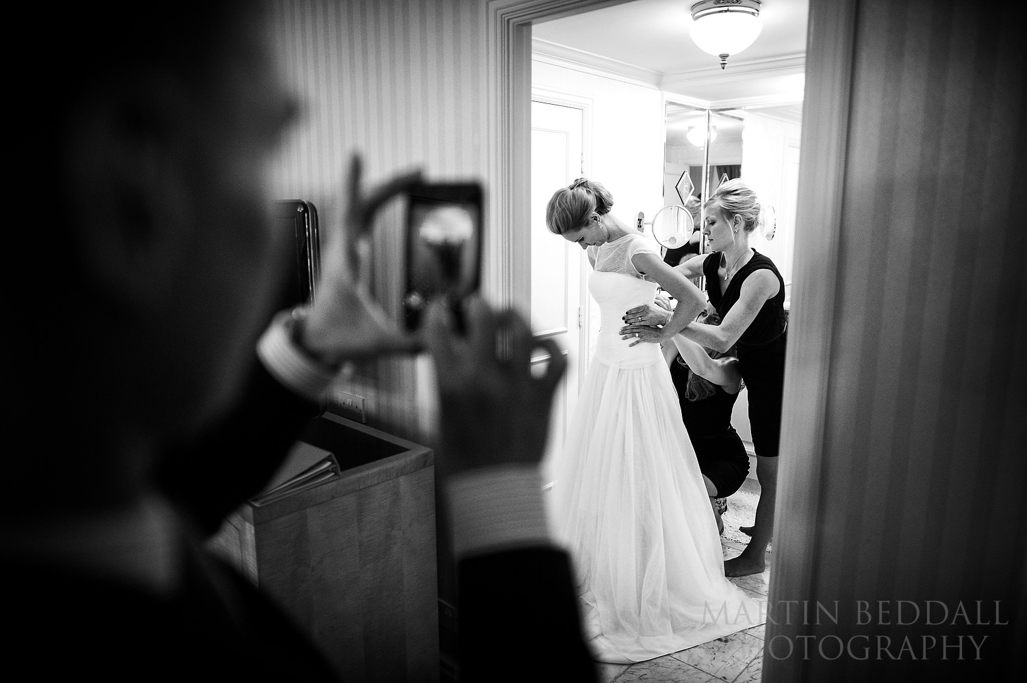 Filming the wedding dress going on