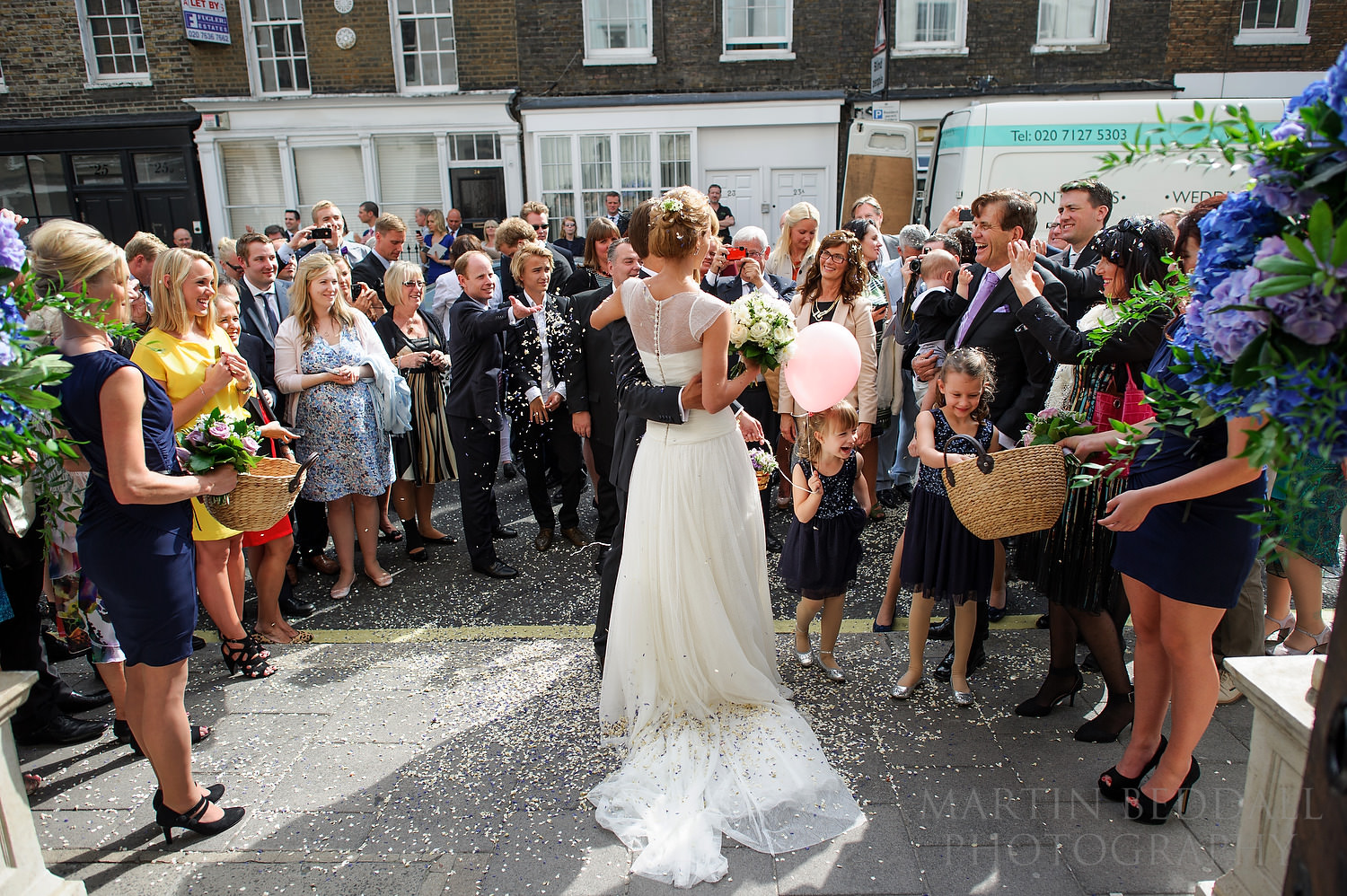 Couple surrounded by guests outside Ulrika Eleonora church