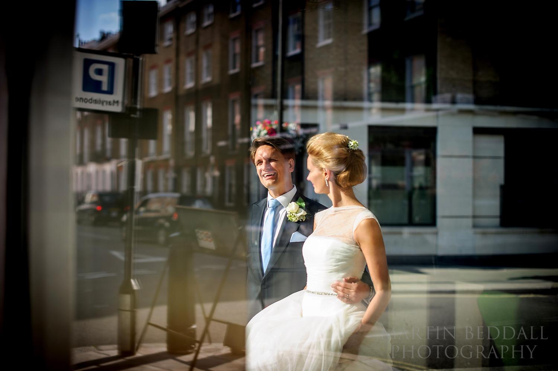 Couple photographed through shop window