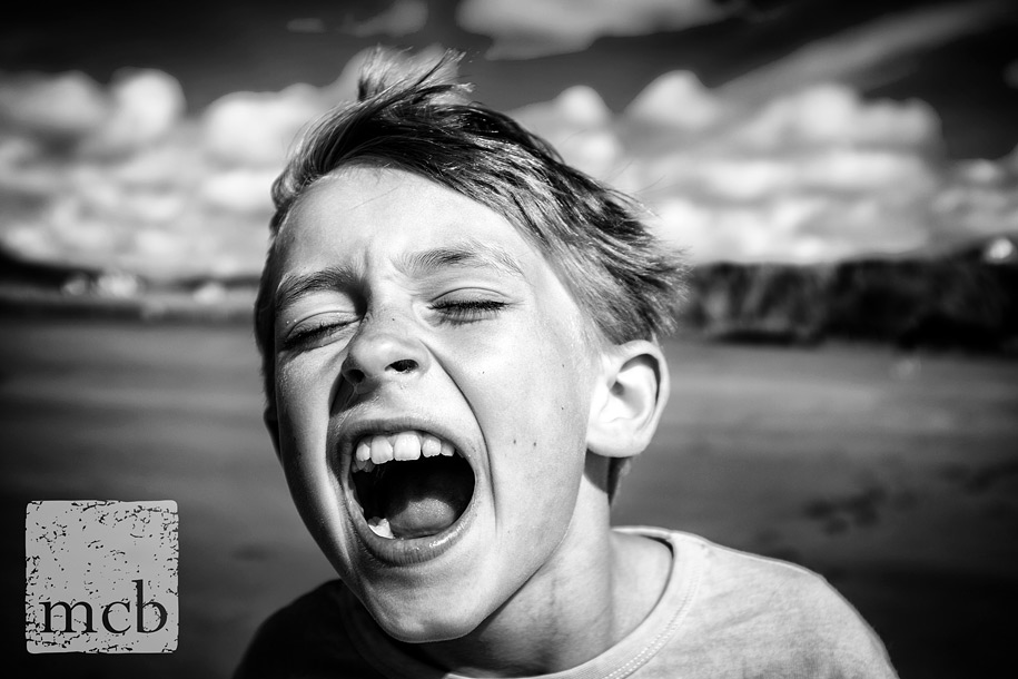 Boy screaming on a beach
