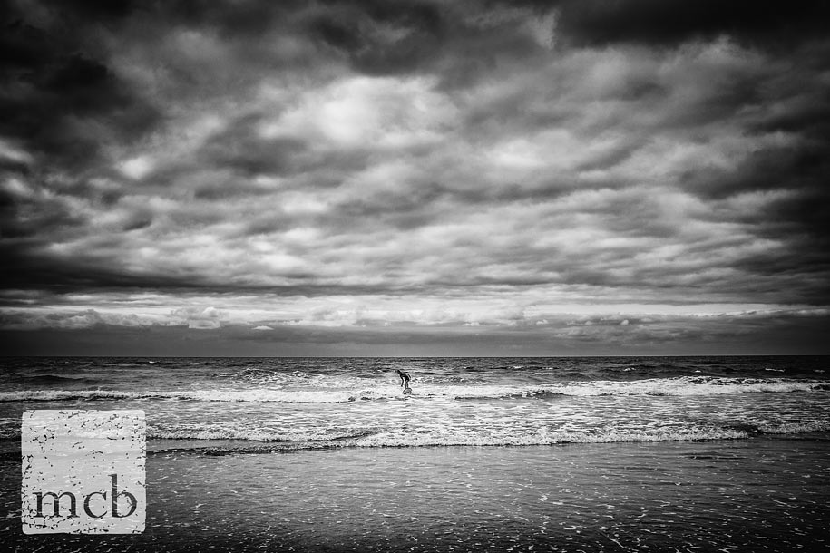 Lone surfer shot on a Fujifilm X100S