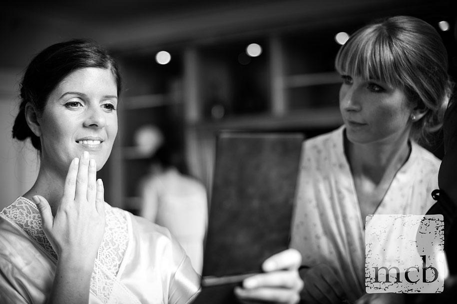Brid eand bridesmaid study her make up