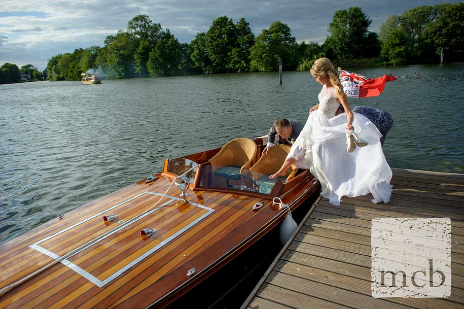 Bride gets into the groom's boat after the weedding ceremony