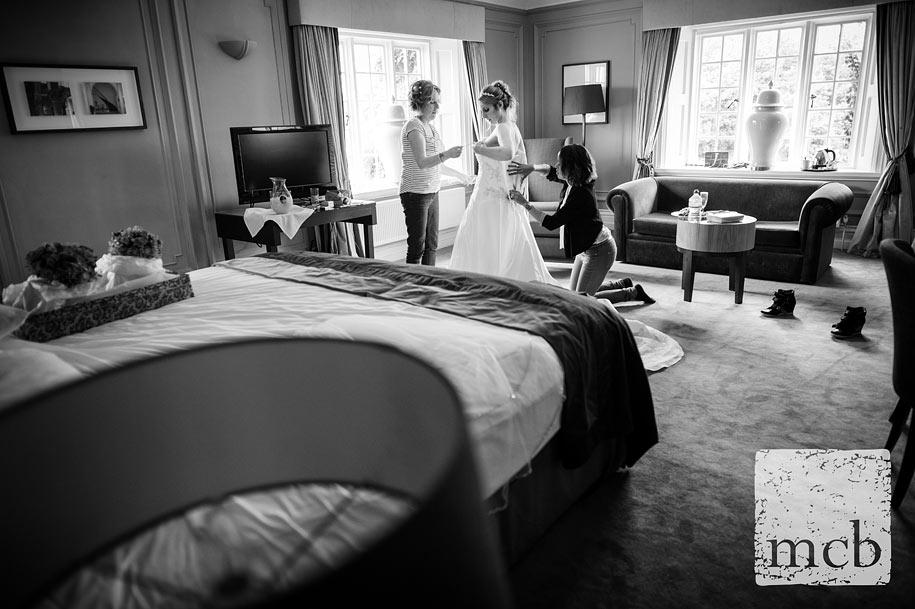 Bride gets into her wedding dress