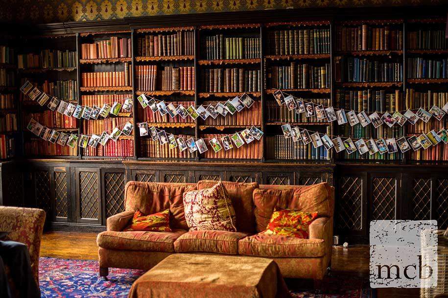 Photograhs decorate the library at Huntsham Court