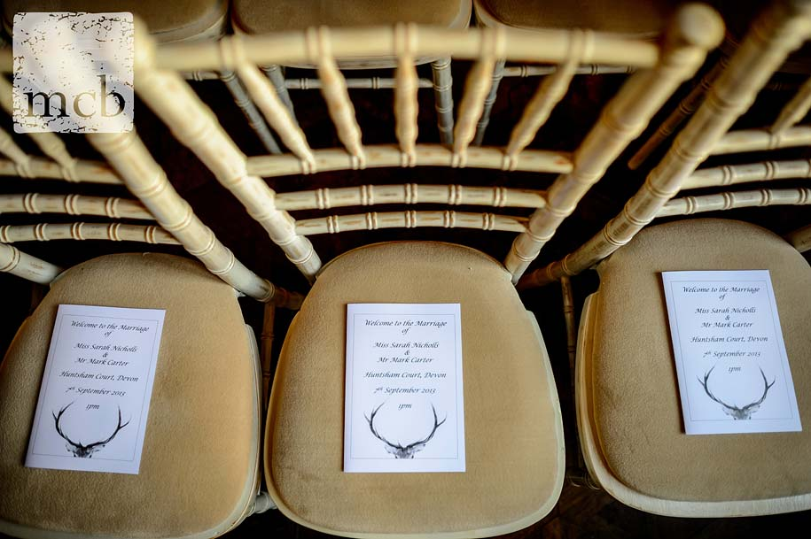 Orders of service on chairs for a Huntsham Court wedding ceremony