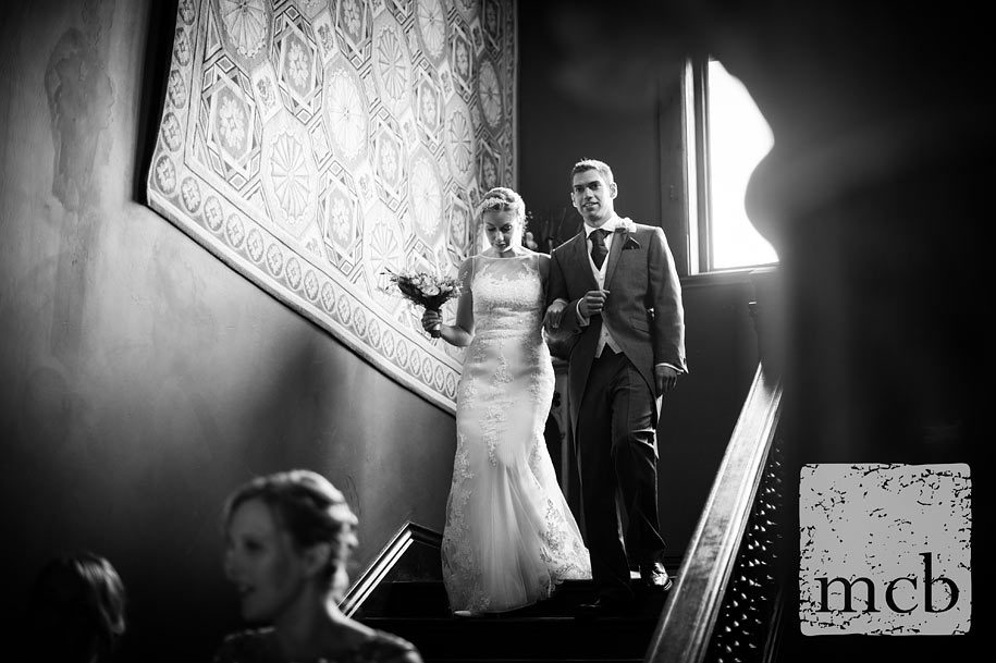 Bride walks down the stairs with her brother