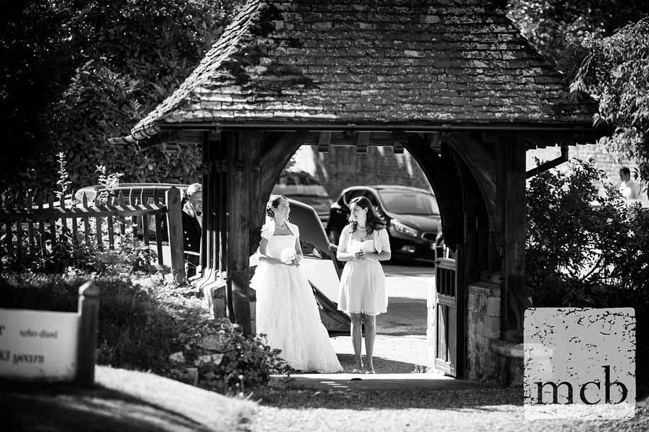 Bride gets ready to walk up to the church in Mickleham