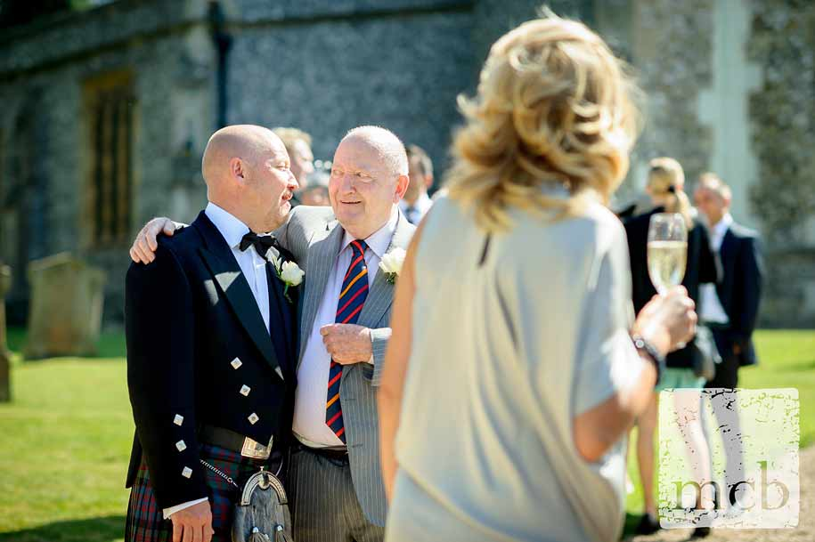 Groom shares a joke with his father