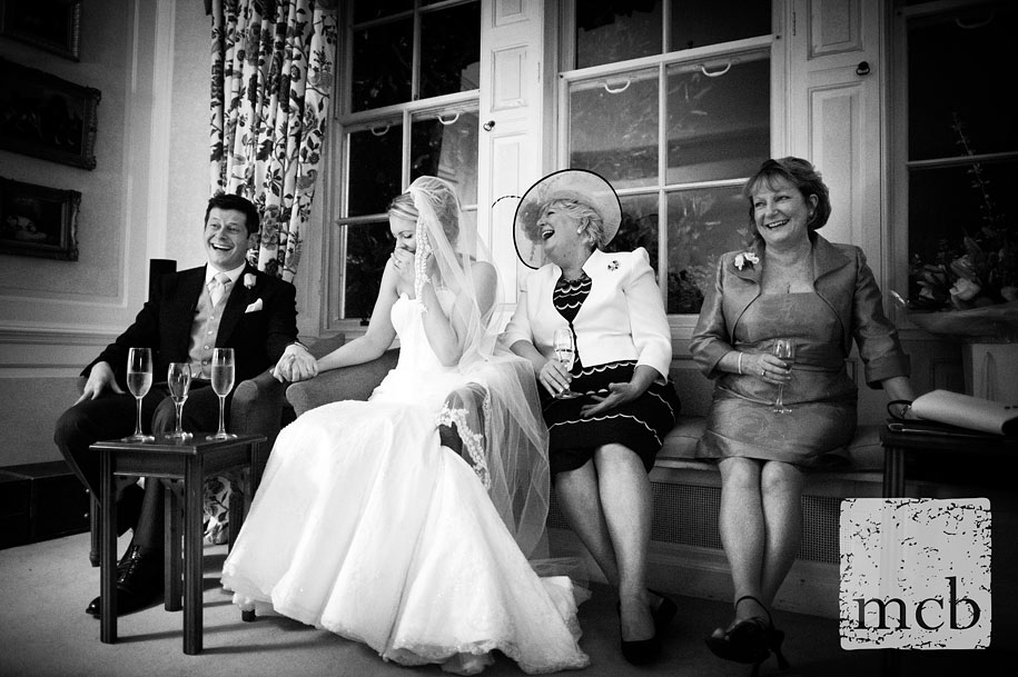 Laughing at the best man's wedding speech