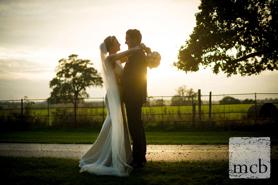 Couple portrait at Blake Hall at sunset